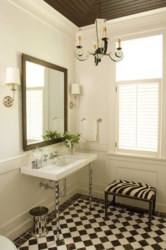 Graphic & Dramatic Bathroom    A dramatic ceiling adds an element of elegance to this classic bathroom design.      A black and white tiled floor and zebra upholstery give this main floor powder room strong graphic elements,