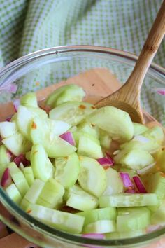 SWEET & SPICY CUCUMBER SLICES: 3 medium cucumbers,  2 tsp kosher salt,  1/2 C rice vinegar,  1/2 C water,  3 T sugar,  1/4 tsp red pepper flakes,  2 T minced red onion