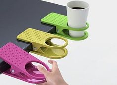 This is a VERY good idea for my computer/homework table.  clip on cup holder