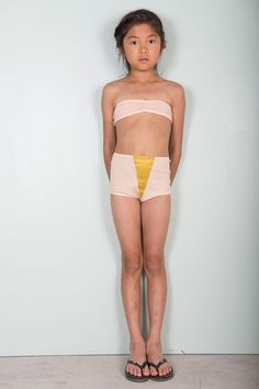 Vintage bikini from Bobo Choses in light pink. Pants with high waist and golden glittery triangle at front and back. Bikini top with elastic and pleats at middle front. Strap to knot at back.