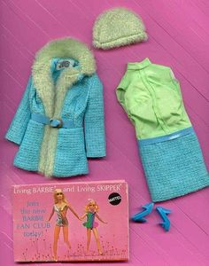 Julia Doll Brr-Furr #1752 (1969 - 1970)  There were two versions of this ensemble. The most commonly found one was in special Julia packaging:   Sleeveless Dress with Lime Green Bodice and Turquoise Blue Woven Skirt   Turquoise Blue Woven Coat with Lime Green Fur Collar and Trim   Lime Green Fur Hat   Turquoise Blue Pilgrim Shoes