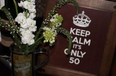 A sign that reminds to keep calm it's only 50 is a playful 50th birthday decorating idea.  See more 50th birthday party decorations and party ideas at www.one-stop-party-ideas.com