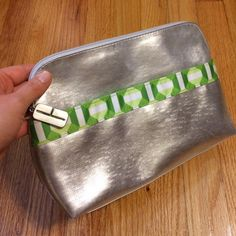 Clinique Metallic Silver and Green Cosmetic Bag Beautiful eye catching color combo. Silver Clinique logo toggle on zipper. Green interior lining with one outer pocket. Well loved and cared for with price accounting wear (makeup marks inside pockets  as shown in pics). 20% off bundles! Thanks for looking! Clinique Bags Cosmetic Bags & Cases