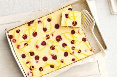 White chocolate, orange and raspberry cheesecake slice main image