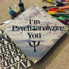 """Decorating your graduation cap is a right of passage! I didn't want to have the stereotypical cap, and I think I succeeded! """"I'm psychoanalyzing you"""" with the all seeing eye and Psi Psychology symbol! Graduation Cap Designs, Graduation Cap Decoration, College Graduation, Graduate School, Psychology Symbol, Psychology Major, Cap Decorations, School Motivation, Grad Cap"""