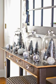 Bottle brush tree forest under glass cloches