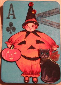 The Old Black Cat by the Pumpkin sat: ATC. Like the playing card used as base.