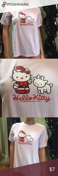 Hello kitty pink Christmas kids L t shirt Sanrio Hello kitty baby pink t shirt with hello kitty dresses like Santa and a reindeer Christmas t shirt size kids large will fit a small woman Hello Kitty Shirts & Tops Tees - Short Sleeve
