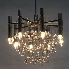 Mid Century Chrome  Chandelier by Sciolari   From a unique collection of antique and modern chandeliers and pendants  at https://www.1stdibs.com/furniture/lighting/chandeliers-pendant-lights/