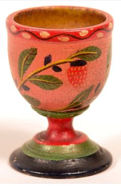 """Conestoga Auctions -  Harry B. Hartman Estate Auction - Session IV  Aug. 15, 2015.  Lot: 603.     Estimate:$500 – $800.  Sold: $1,029.    Description:  Lehnware Strawberry Pattern Master Salt or Egg Cup. (Joseph Long Lehn, 1798-1892, Clay Township, Lancaster County, Pennsylvania). Turned poplar wood, polychrome painted with salmon ground and yellow interior. 2-5/8""""h. Condition: Very good with minor losses and soiling."""