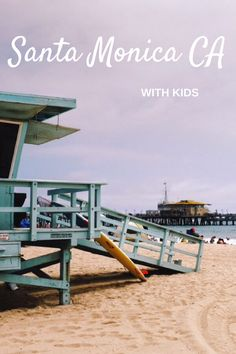 Visitor's guide to Santa Monica, California, with tips and advice on what to do in Santa Monica with kids. In the photo, Santa Monica beach with lifeguard station and the pier in the background, also a great place to hang out when visiting Santa Monica with kids in tow! #california #usa #familyvacation #familytravel #beach