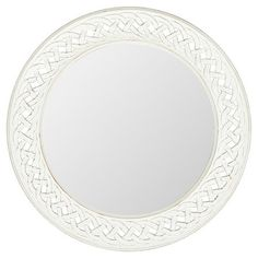 Accent your walls in chic appeal with this eye-catching mirror, showcasing a white frame with an openwork links motif.  Product: