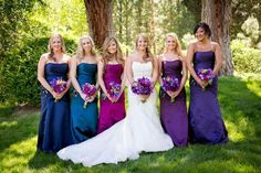 Peacock Inspired Wedding - I love the different color and long dresses! I love the peacock color scheme! Bridesmaids And Groomsmen, Wedding Bridesmaid Dresses, Peacock Wedding Dresses, Rainbow Bridesmaids, Peacock Wedding Colors, Bridesmaid Color, Wedding Flowers, Purple Peacock, Peacock Colors