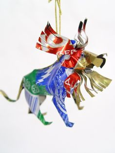 Unpainted Tin Lion Ornament, Handmade from recycled tin cans in Zimbabwe. $8