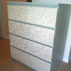 Ikea malm dresser... Painted, drawers are covered with fabric using adhesive spray