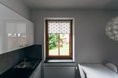Black DOT mini roller blind by MOTIVO. Simple and beautiful.