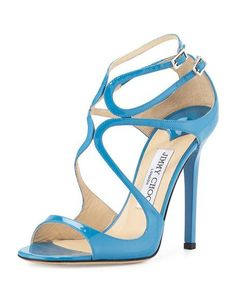 """Jimmy Choo patent leather sandal with golden hardware. 4"""" lacquered heel. Open toe. Curvy caged vamp. Double-adjustable ankle straps. Lightly padded footbed. Smooth outsole. Leather/suede lining. """"Lan"""