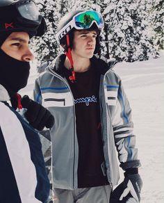 My husband snowboarding
