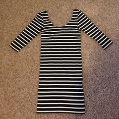Bebe 3/4 sleeve black and white stripe dress Brand new Bebe black and white stripe bodycon dress. bebe Dresses
