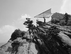 John Harris preparing for the first hang glider flight off Grandfather Mountain, July 13, 1974.
