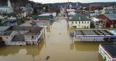 Flood-battered cities brace for more damage after deadly storms