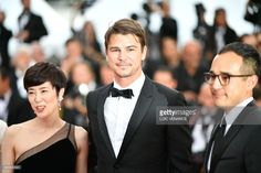 US actor Josh Hartnett (C) and Japanese actress Shinobu Terajima (L) arrive on May 22, 2017 for the screening of the film 'Oh Lucy!' at the 70th edition of the Cannes Film Festival in Cannes, southern France. /