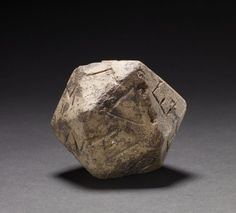 Stone Dice  Greek  1st Century AD  20 sided dice made of stone, inscribed with letters of the Greek alphabet (from alpha to upsilon)  (Source: The British Museum)