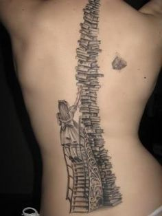I love the shading of this work. Yes it's a tattoo, but still a drawing in ink. There's an intricate design in the stair steps, dimension in the books and skirt, also the stack of books interest me because each one varies to the next.