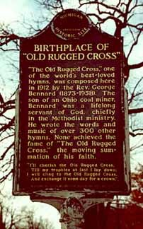 """""""The Old Rugged Cross,"""" one of the world's best loved hymns, was composed in Albion, Michigan in 1913 by the Reverend George Bennard (1873-1958). Pinner said:  The son of an Ohio coal miner, Bennard was a lifelong servant of God, chiefly in the Methodist ministry. He wrote the words and music of over three hundred other hymns. None achieved the fame of """"The Old Rugged Cross,"""" the moving summation of his faith."""