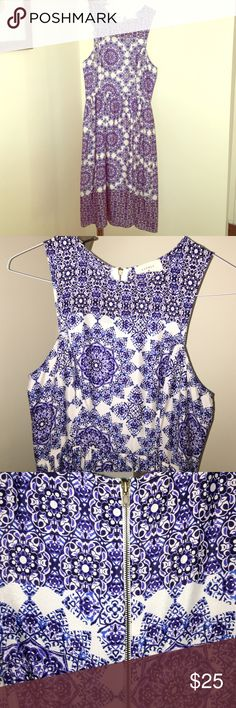 Midi dress Only wore once and dry cleaned! Printed midi dress. Shades of blue, purple, black, and white. Exposed zipper on back. Sleeveless. Lined. 100% polyester. Tag reads large but fits more like a medium. Everly Dresses Midi