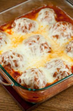 This Baked Meatball Parmesan from Wishes and Dishes is easy to make and has no mess or frying! Cheesy meatballs with tomato sauce baked right in the oven make the most delicious dinner!