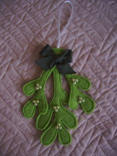 Handmade Felt Mistletoe Hanging Decoration with pearl berries. £3.50, via Etsy.