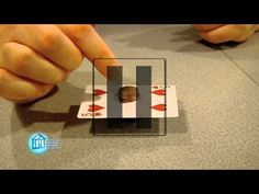 Inertia allows us to do all kinds of fun things - like this little challenge. Can you get the card out from the middle of a stack of coins?