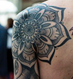 Tattoo on the shoulder of the man - Mandala