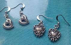 TWO PAIRS of heart shaped silver plated earrings by StuffByStace, $10.00