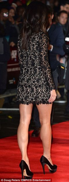 Gorgeous shot of Sandra Bullock's stunning legs in a short dress and high heels on the red carpet at London's Odeon Leicester Square