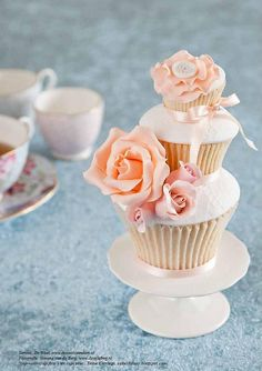 Another gorgeous tiered cupcake. this wedding cupcake by Cakes by Tess is just beautiful.Love the roses and pretty pink and peach colours. Floral Cupcakes, Pretty Cupcakes, Beautiful Cupcakes, Yummy Cupcakes, Cupcakes Bonitos, Cupcakes Lindos, Mini Cakes, Cupcake Cakes, Tolle Cupcakes