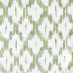 An ikat fabric in fern green on a white background.Suitable for upholstery, drapery, curtains, roman blinds, cushions, pillows and other home decor accessories.