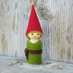 Our cute boy gnome peg doll is perfect for little hands. Standing at 2 1/2 inches tall, he is dressed in olive green with brown belt and red gnome hat. He would make a lovely party favor, or sweet lit