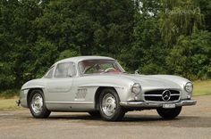"""1954-63 Mercedes 300SL Coupe, inline 6-slant mount/220-40hp/4 spd, 180""""l, 135to146mph, 0-60-8.8s, orig cost-8-11kwith racing cam/lt body, current-1.5m, production-11,300."""