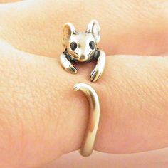 This gold mouse ring is slightly adjustable with a gentle squeeze. It fits a size 5-9. He is sweet with Swarovski Crystal eyes and big ears as this little guy wraps around your finger, the other end w