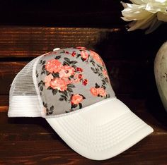 Best selling grey floral design available in a variety of colors-snapback one size fits all trucker hat.