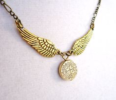 Harry Potter Golden Snitch Necklace  by ViperCoraraDesigns on Etsy