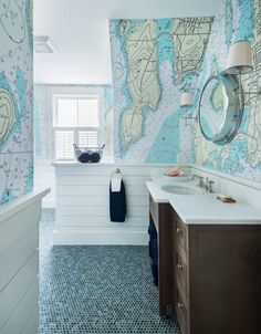 custom designed wallpaper featureing jamestown, rhode island compliments the shiplap and the ocean blue penny round tiles