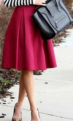 Womens Vintage style office midi skirt with hidden back zipper and semi elastic waist in red.