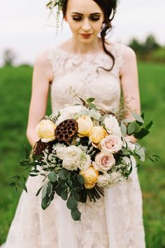 natural, whimsical, rustic bride's bouquet flowers in ivory, bush, pale gold, and brown for outdoor summer farm wedding by www.redpoppyfloral.com