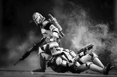 Clone Commander Wolffe drags a wounded clone out of a kill zone after being ambushed by separatist forces. Toy photography by instagrammer galactic_warfighters.