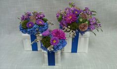 Gift box flower arrangements.