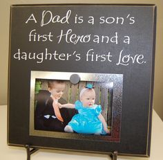 A Dad is a son's first hero and a daughter's first love-Vinyl Lettering on a Square magnetic picture board. $25.00, via Etsy.