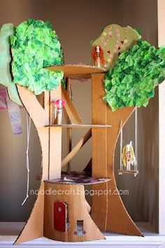 Love this cardboard treehouse toy. Perhaps I could do a similar thing to make a rocket ship too!